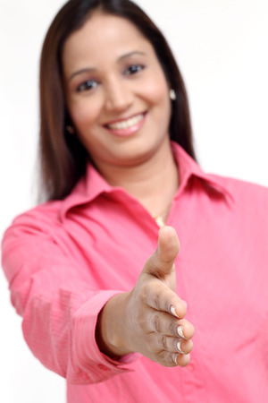 successful woman: Young successful woman handshake against white background