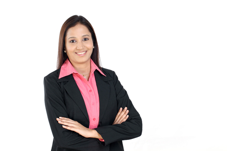 Beautiful Indian business woman with arms crossed on white photo