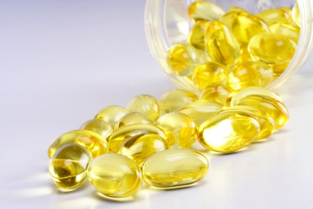 cod oil: Close up of cod liver oil pills  Stock Photo