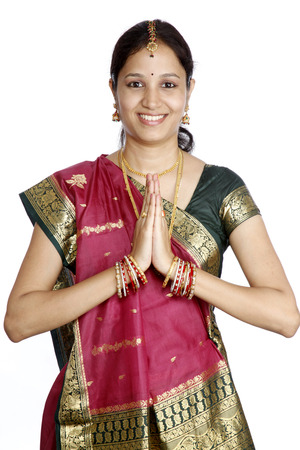 namaste: Traditional Indian girl holding hands in prayer position Stock Photo