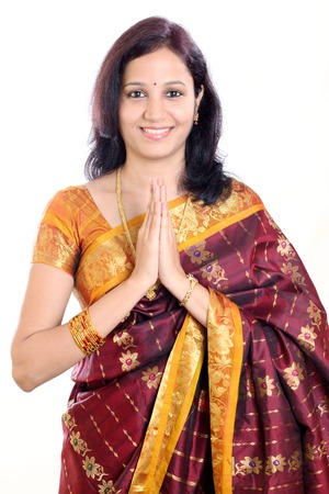 beautiful indian girl face: Traditional Indian girl holding hands in prayer position Stock Photo