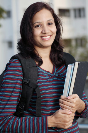 Smiling Indian female student holding books  Stock Photo - 27216926