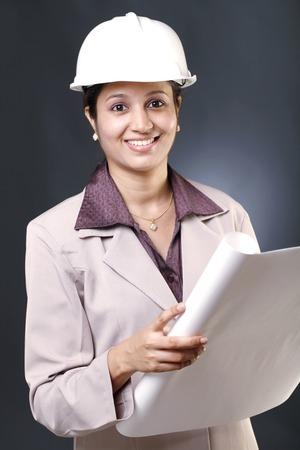 Happy young Indian female architect photo