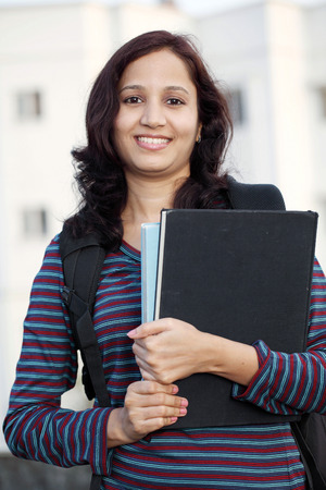indian college student: Smiling young female college student at campus