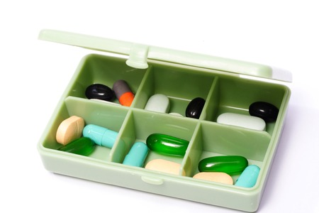 Pills in Pill Box on white background