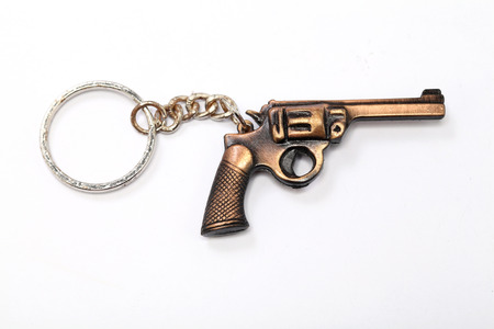 misdemeanor: Toy gun with keychain isolated on white background
