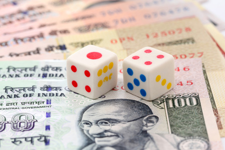 indian currency: Indian currency notes and dice on white background