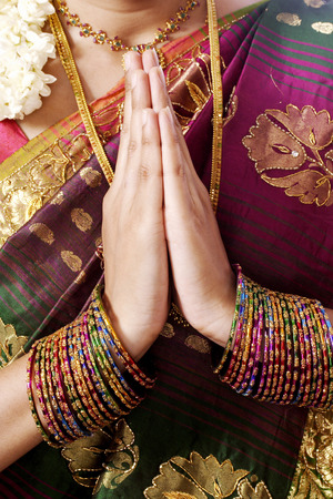 Traditional Indian girl holding hands in prayer position Stock Photo
