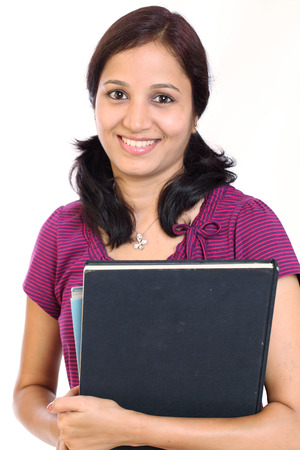 Smiling Indian female college student on white background photo