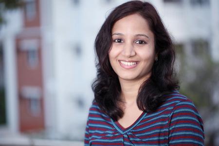 Cheerful young Indian teenage girl