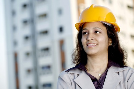 Portrait of young Indian female construction engineer photo