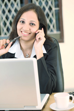 sinecure: Happy young business woman talking on cellphone Stock Photo