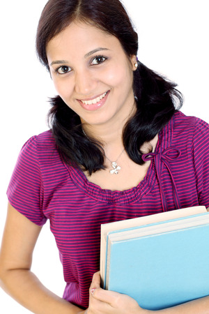 Cheerful young Indiian female student with books in her hand photo