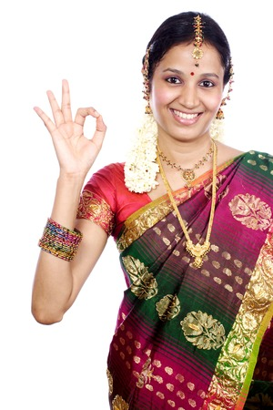 1 young woman only: Traditional Indian  young woman showing OK sign against  white background
