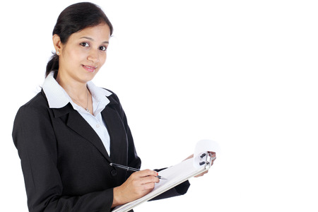 Young Indian female entrepreneur taking notes  photo
