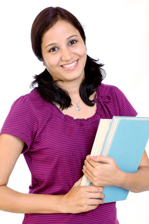 Cheerful young female college student with books in her hand photo