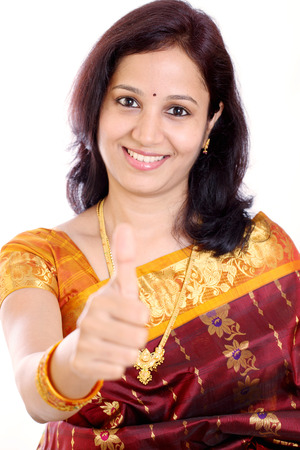 indian saree: Traditional young Indian woman showing thumbs up  Stock Photo