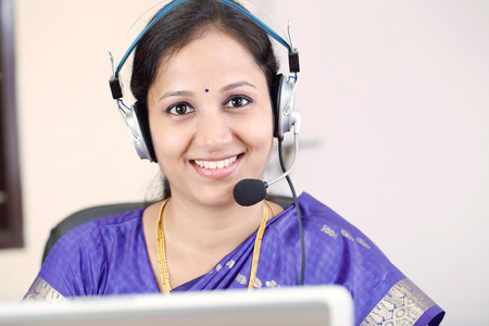 Closeup of Indian business woman with headset photo
