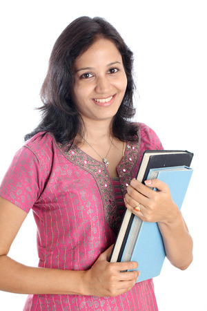 Happy young Indian college student with books in her hand photo