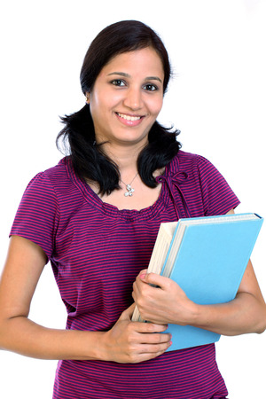 Portrait of smiling female student against white  photo