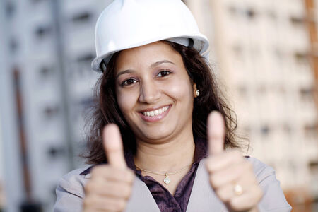 Successful young Industrial engineer with thumbs up gesture photo
