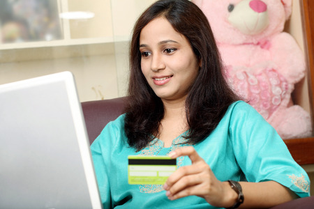 Young Indian woman shopping online from home