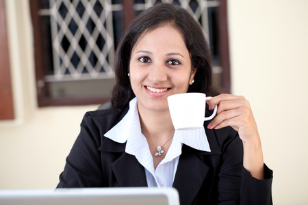 Businesswoman in office with coffee  photo