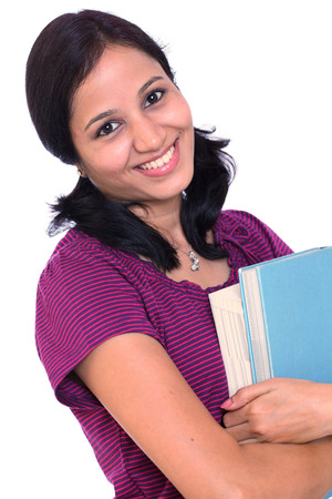 Smiling Indian female college student holding books in her hand photo