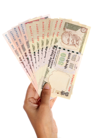 five rupee: Hand with Indian five hundred and thousand rupee notes  Stock Photo