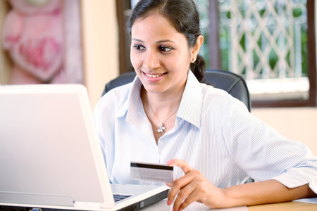 Young Indian woman doing online shopping at home