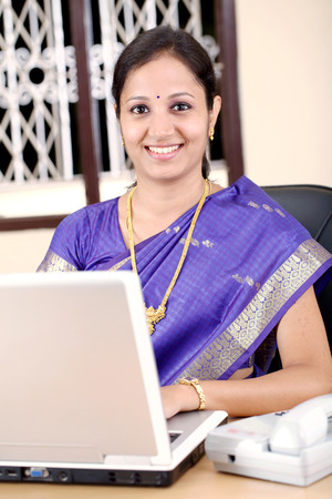 Smiling Indian business woman working in the office  版權商用圖片