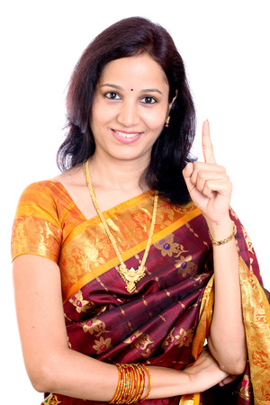 admonish: Traditional Indian woman holding her index finger up against white