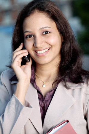 Young indian businesswoman talking on cell phone  photo