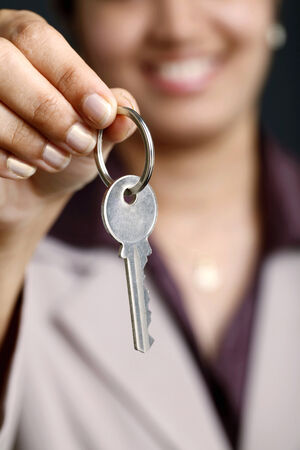 Closeup view of business woman holding a key photo