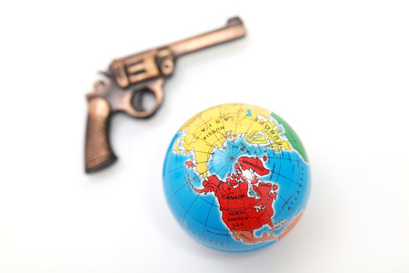 misdemeanor: Globe and gun on white background - crime and world