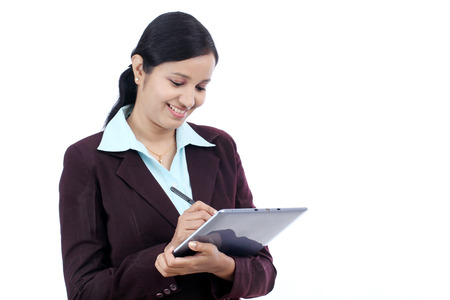Young Indian business woman with tablet and stylus against white background photo
