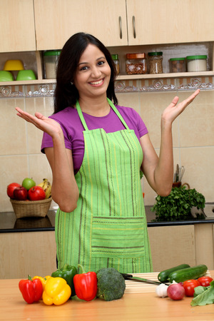 indian ethnicity: Excited young Indian woman in kitchen