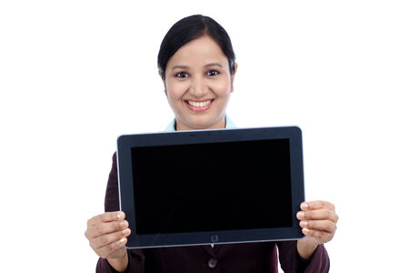 Happy young business woman showing tablet computer screen against white photo