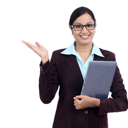 Young business woman holding blank copy space on her open palm and holding a tablet computer  photo