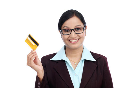 topicality: Happy young Indian business woman with credit card against white background Stock Photo