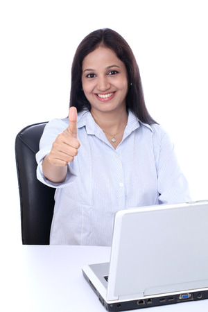 buisiness: Happy young buisiness woman showing thumbs up against white background