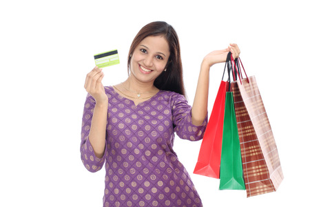 lovely woman: Cheerful Indian woman with shopping bags against white background