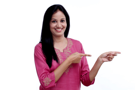 woman pointing to up against white background