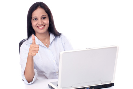 Happy young buisiness woman showing thumbs up against white background