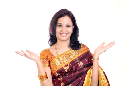 Excited traditional young Indian woman against white background