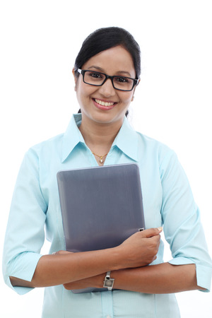 Happy young business woman with tablet against white background