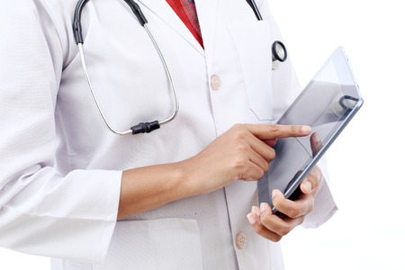 Closeup view of doctor using tablet computer photo