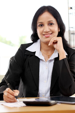 Young business woman working with tablet computer at office Stock Photo