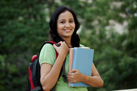 girl notebook: Happy young female student at college campus and carrying books