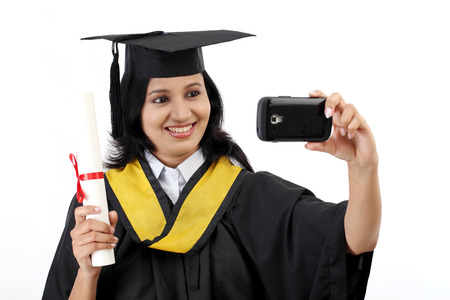 Young female graduated student taking selfie photo
